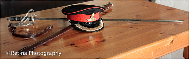 Ceremonial Sword and Cap on Pine Table