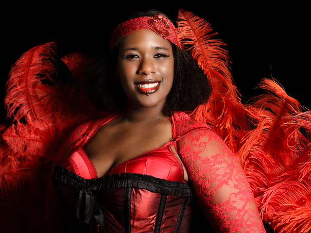 Burlesque Performer In Bright Red Feather Outfit