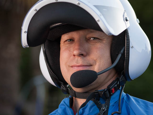 Portrait of Microlight Aircraft Pilot Wearing White Helmet and Blue Overalls
