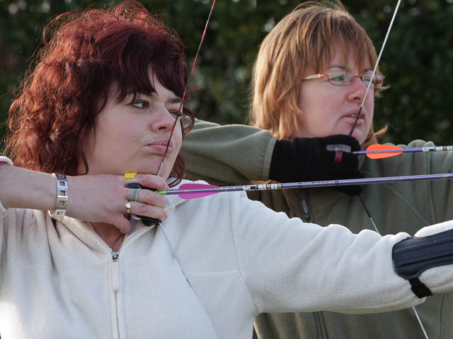 Female Archery Competitors In Training