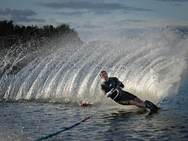 Water Skier On The Turn Kicking Up Spray