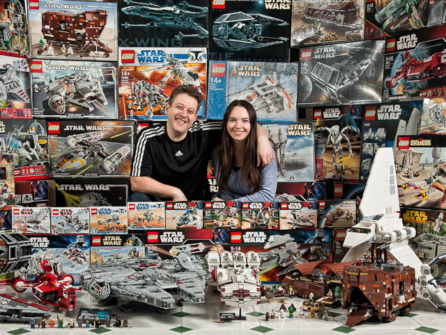Star Wars Collectors Surrounded By Boxes And Models