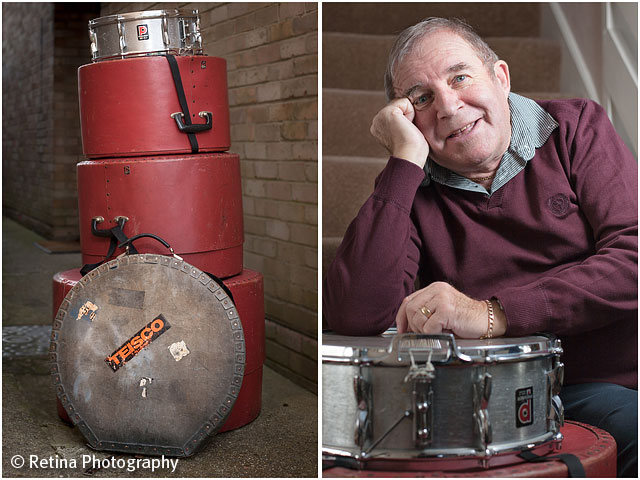 Portrait of Drummer With Stacked Drum Kit in Cases