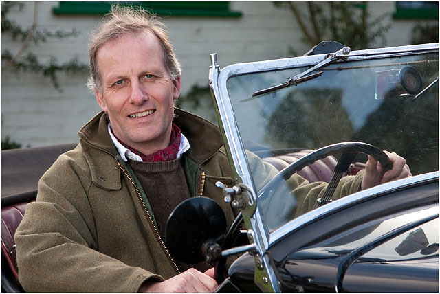 Man Sat At Wheel Of Morris Eight Classic Car