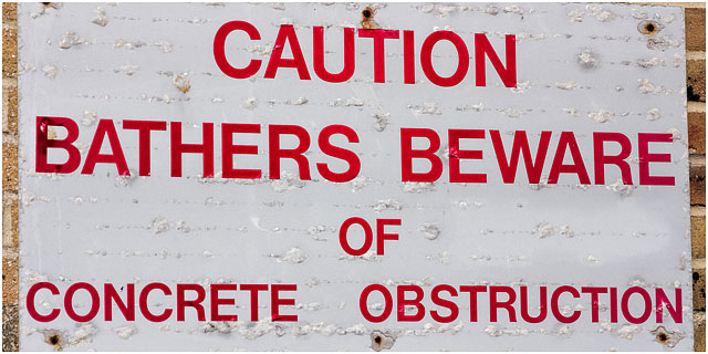 Caution Bathers Beware Of Obstruction Wall Sign