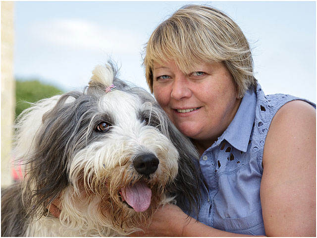 Female Beach Swimmer With Bearded Collie Pet Dog