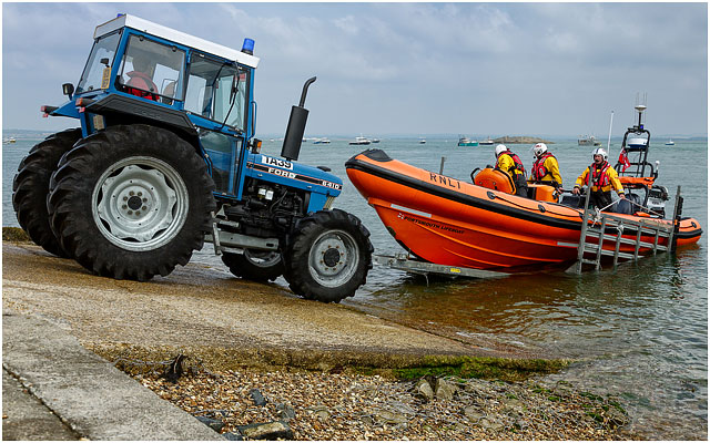 Portsmouth Rnli B Class Atlantic 85 Inshore Rescue Boat Entering The Water By Trailer