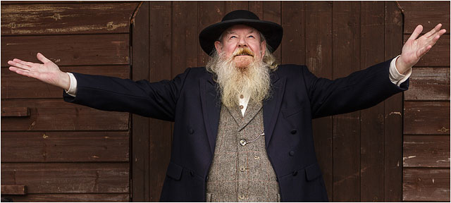 American Wild West Preacher With Arms Outstreached Looking Heavenwards
