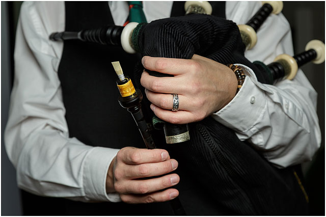 Bagpipes chanter reed held by bagpipe player