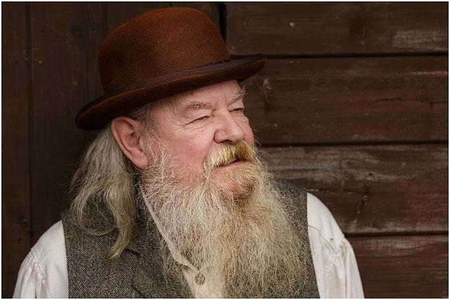 Head And Shoulders Portrait Of Man In American Wild West Tweed Waistcoat And Brown Bowler Hat