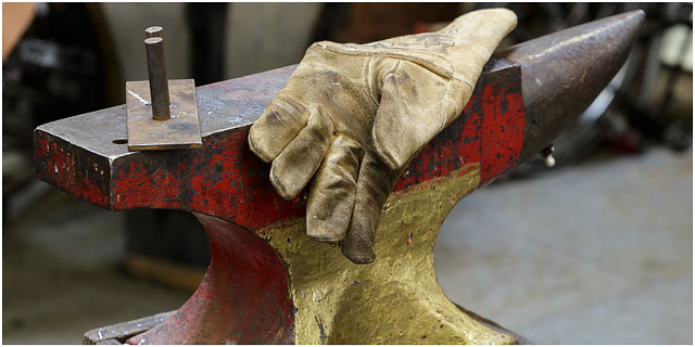 Blacksmiths Glove Laying On Brightly Coloured Anvil