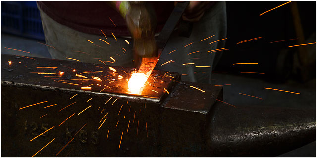 Hammering Metal On Anvil With Flying Sparks