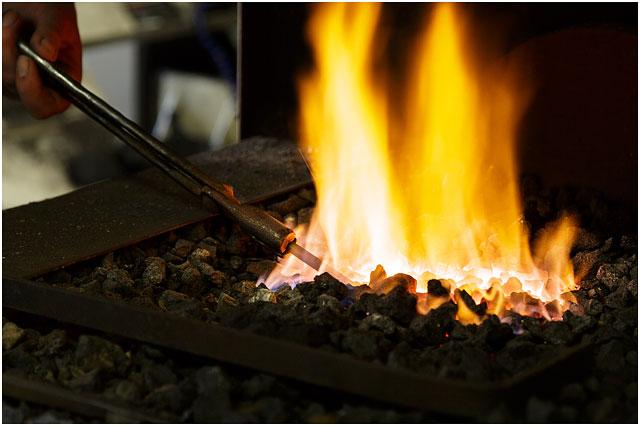 Heating Steel Rod In Blacksmiths Forge