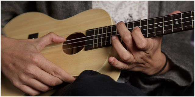 Close Up Of Finger Positions On Ukulele