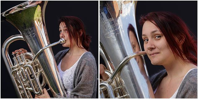 Female Tuba Player Holding E Tuba And Playing