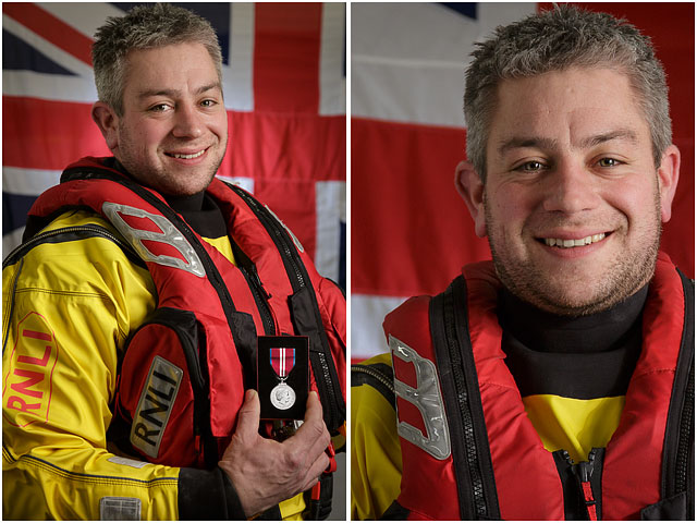Portsmouth RNLI Volunteer With Queens Jubilee Medal with White Ensign Flag in Background
