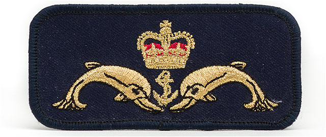 Royal Navy submariners cloth uniform badge featuring dolphins an anchor and a crown.