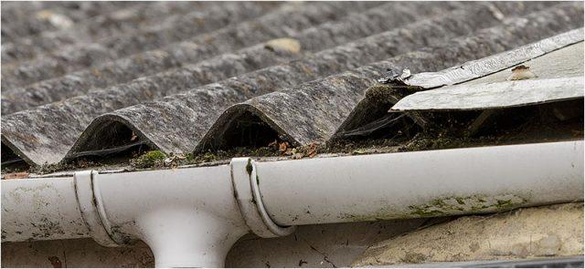 Asbestos roof panels