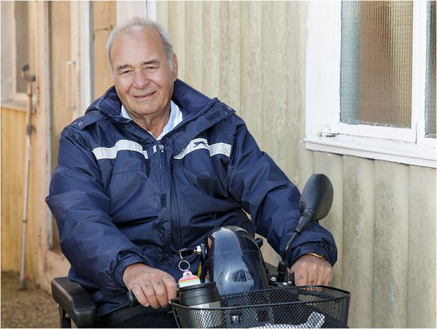 Portrait of motability scooter user outside the Havant Men's Shed