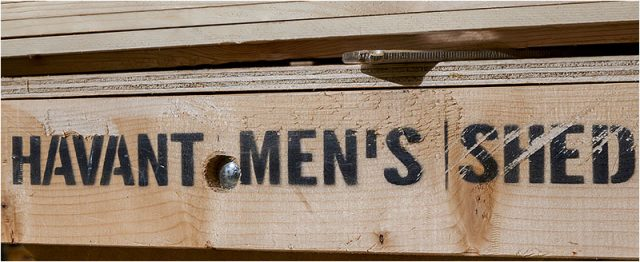 Havant Men's Shed name stencilled on a wooden bench