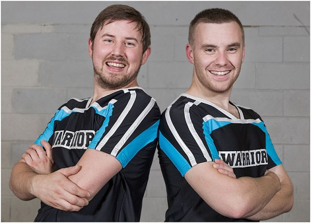 two male portsmouth warriors wearing the team t-shirts portrait headshots