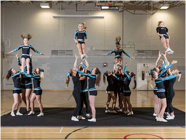 stunting with portsmouth warriors cheerleaders