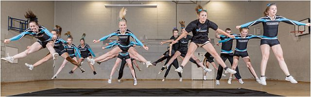 portsmouth warriors cheerleaders practising a synchronised jump