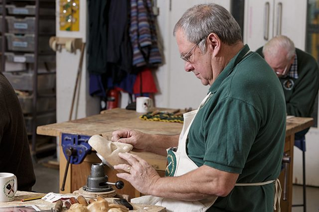 woodcarver at work during a solent woodcarver and sculptors guild carve-in
