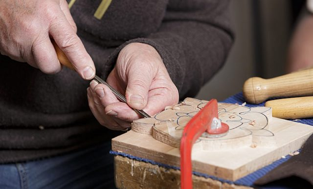close up of woodcarver at carve-In day for solent guild of woodcarvers and sculptors at portsmouth grammar school