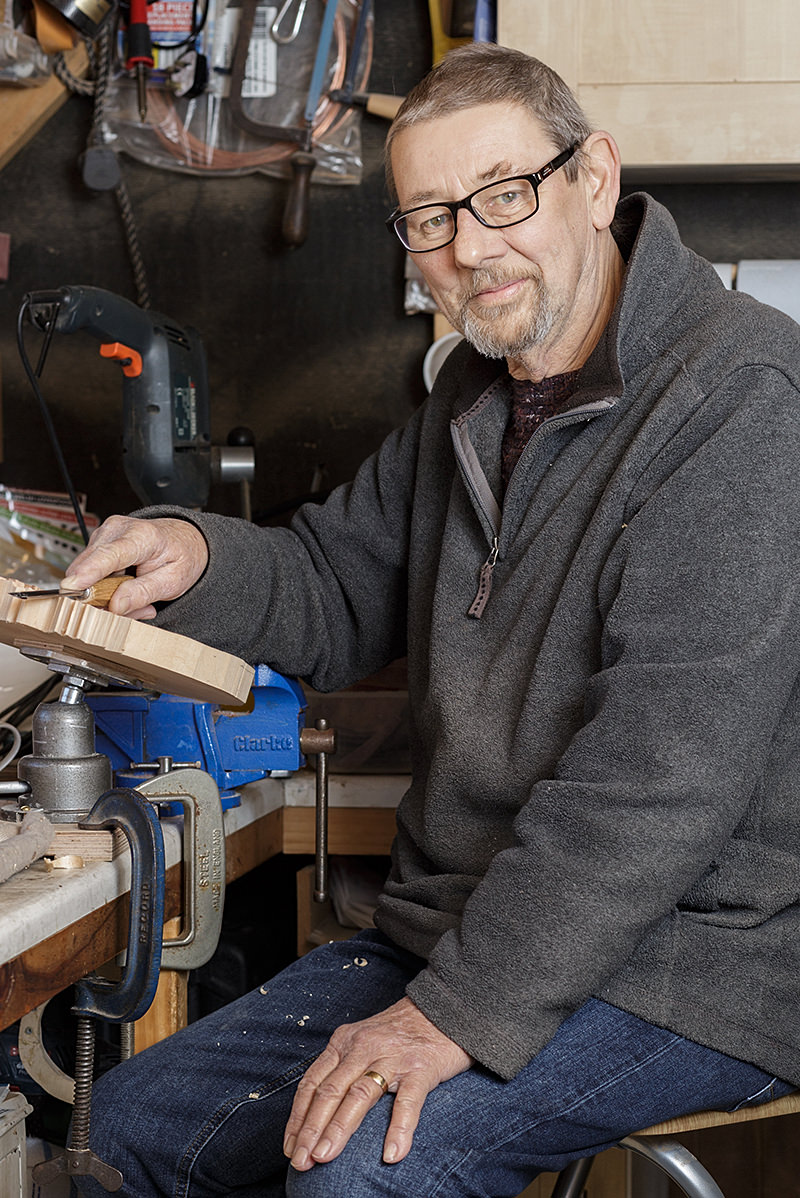 portrait of paul barton a member of the solent guild of woodcarvers and sculptors at home in his workshop