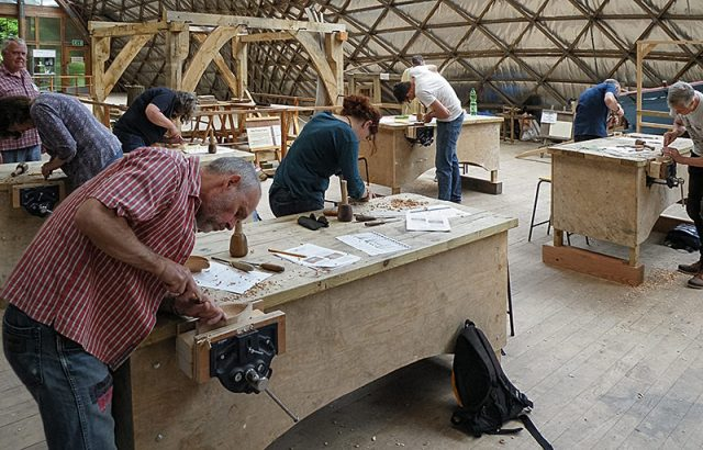 woodcarvers during demonstration day at weald and downland museum