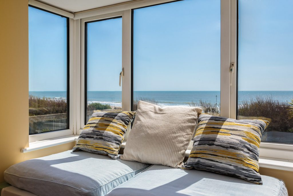 picturesque scene looking out to sea from a bedroom