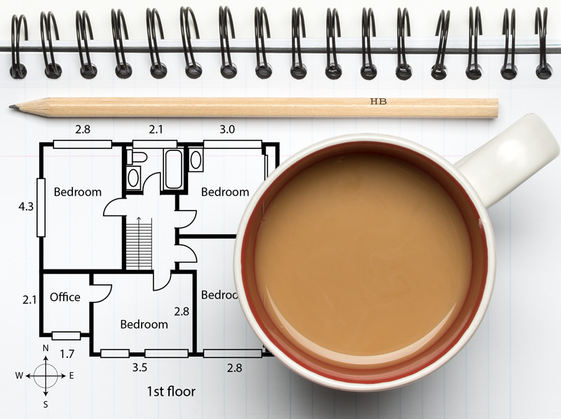 property blog notebook with floorplan coffee cup ring binder and pencil