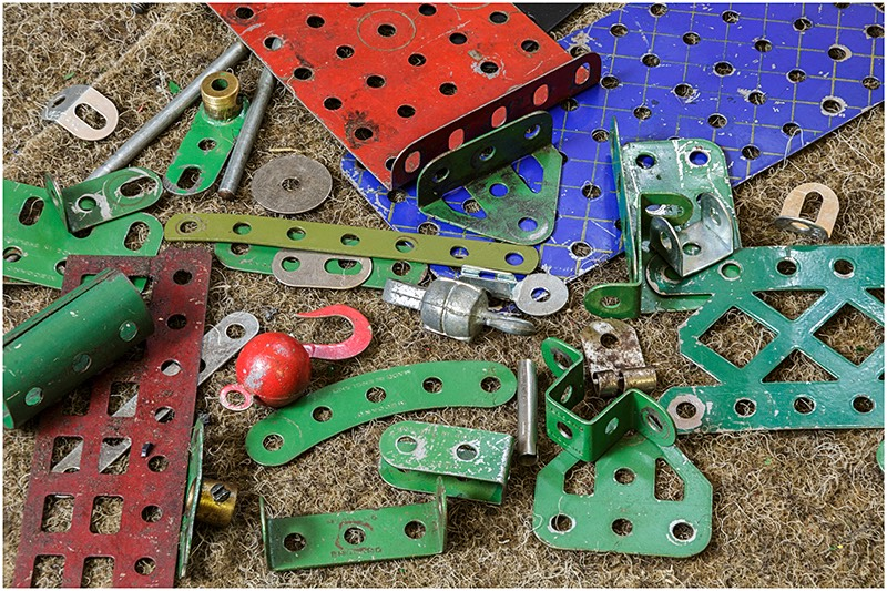 Collection of original Meccano parts in a pile