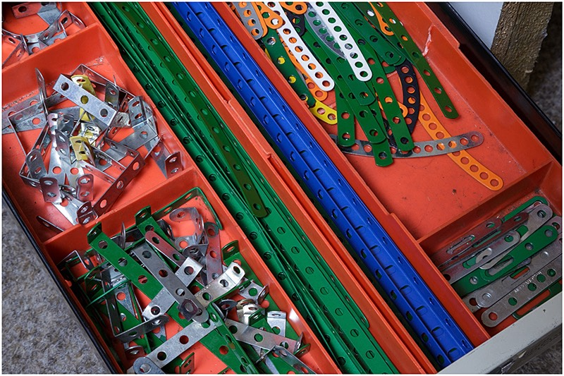 Different coloured Meccano parts