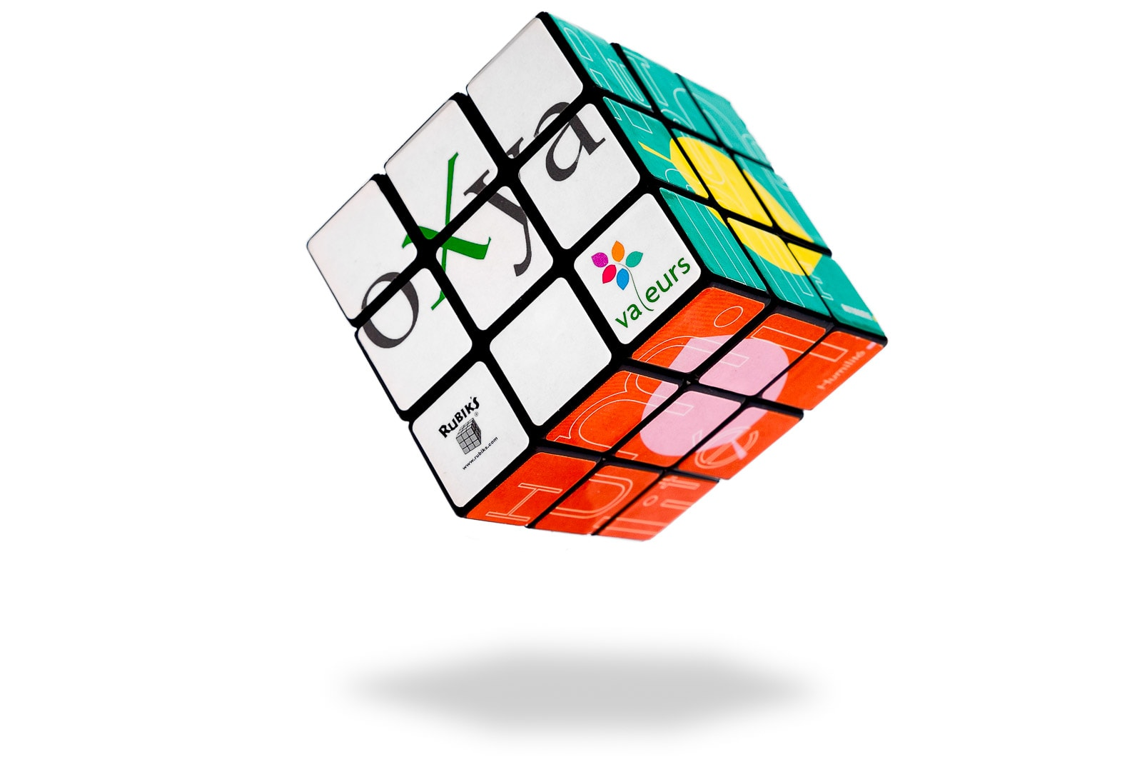 floating oxya rubiks cube business merchandise on white background