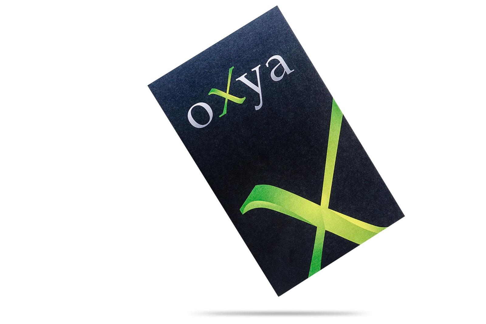 floating oxya uk business card design on white background