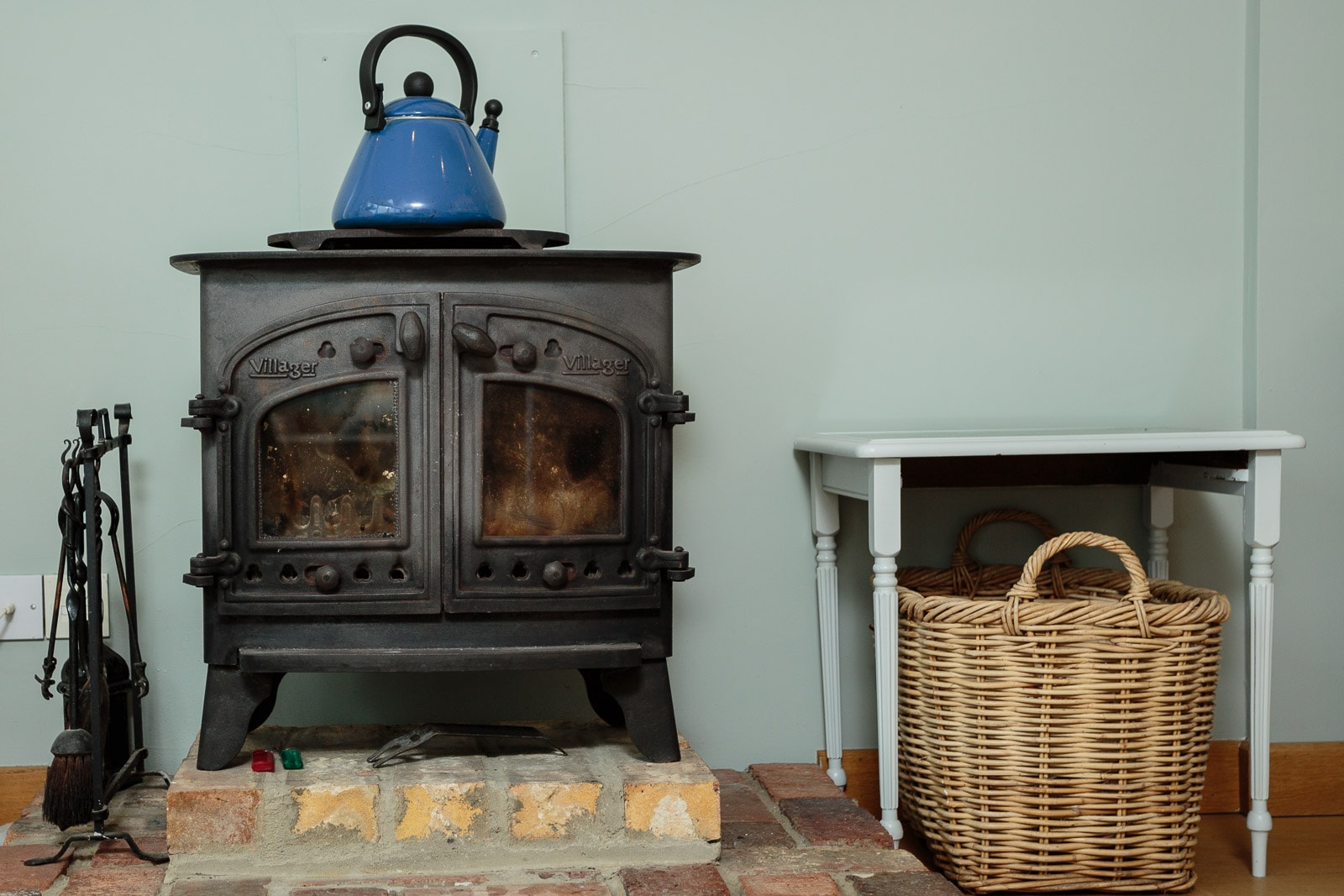 Victorian wood burner and blue kettle, log basket and tools