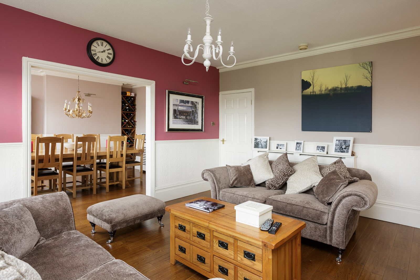 mix of modern colour scheme with traditional furniture in the living and dining area of a townhouse