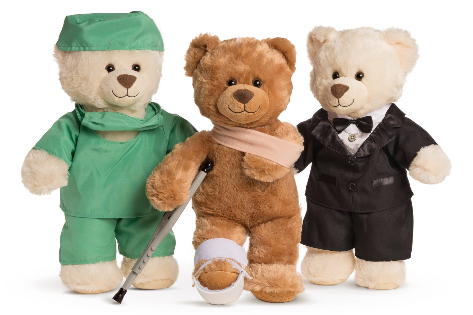 spire healthcare teddy bears wearing scrubs a suit and on crutches on white background