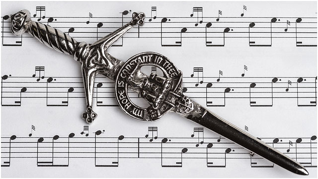 Scottish Bagpipe Music Notation With Ceremonial Dirk